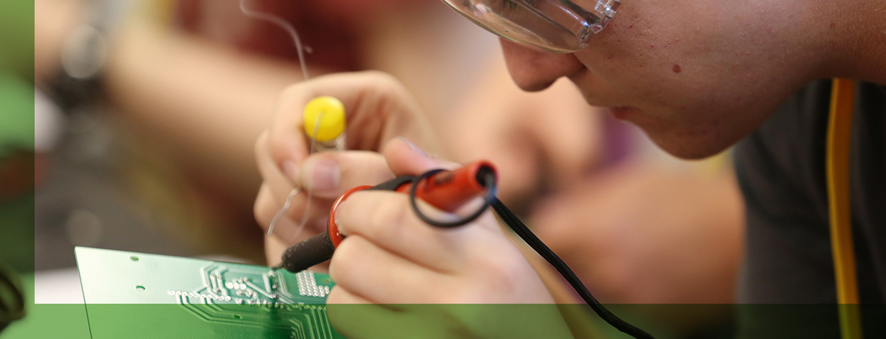 Cyber Miner campers solder electric boards for small cars.